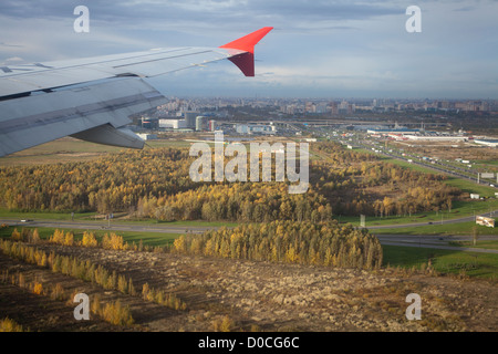 View from the airplane. The plane is landing. Saint-Petersburg, Russia. - Stock Photo
