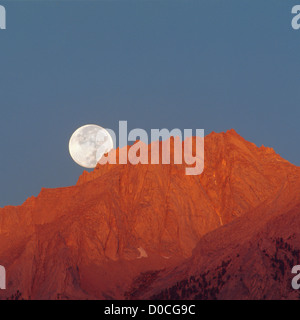 Full Moon Sets Behind Mount Russell at Dawn - Stock Photo