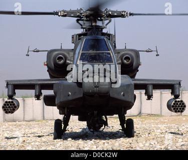 AH-64 Apache Gunship Idles on a Dirt Landing Strip at Jalalabad, Afghanistan - Stock Photo
