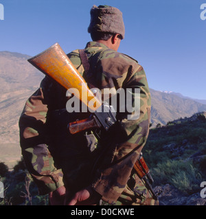 An Afghan National Army Soldier Scans Mountains During Raid on Suspected Al Qaeda Training Camp in Foothills Afghanistan's - Stock Photo