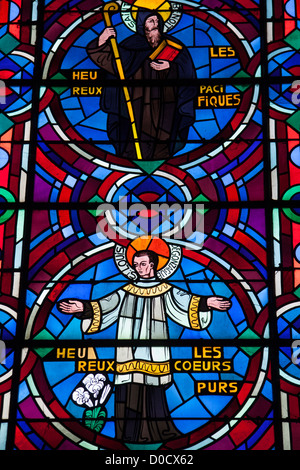 SAINT BENEDICT SAINT ALOYSIUS GONZAGA BLESSED ARE PEACEMAKERS PURE HEART STAINED-GLASS WINDOW IN ABBEY CHURCH NOTRE - Stock Photo