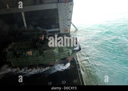 An amphibious assault vehicle (AAV) departs the amphibious transport dock ship USS Green Bay (LPD 20) during a routine - Stock Photo