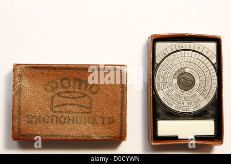 Old photographic exposure meter from USSR in case - Stock Photo