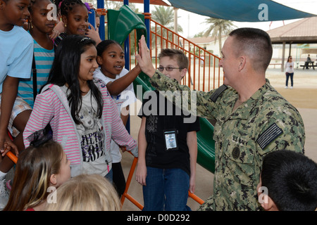 Master Chief Petty Officer of the Navy (MCPON) Mike D. Stevens meets students at the Bahrain Department of Defense - Stock Photo
