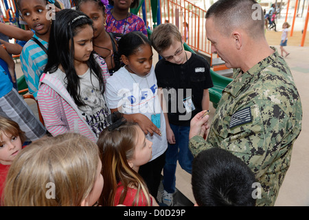 Master Chief Petty Officer of the Navy (MCPON) Mike D. Stevens speaks with students at the Bahrain Department of - Stock Photo