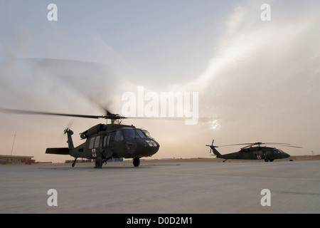 US Army UH-60 Blackhawk MEDEVAC Helicopters Prepare Launch on Nighttime Mission Baghdad Al Asad Air Base in Iraq's - Stock Photo