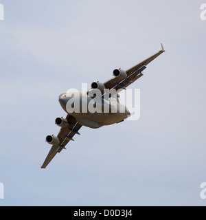 A US Air Force C-17 Globemaster Makes a Steep Bank Turn - Stock Photo