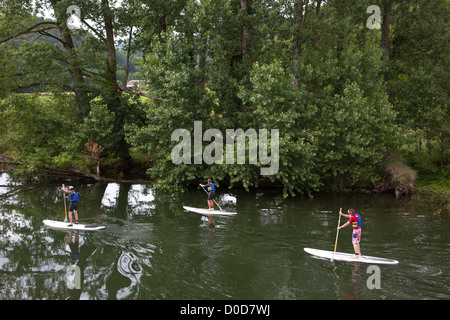 SUP ACTIVITY STAND UP PADDLE GOING DOWN THE LOT RIVER STANDING ON A SURFBOARD SAINTE-EULALIE D'OLT AVEYRON (12) - Stock Photo
