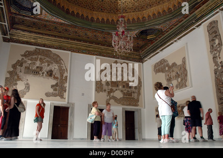Tourists admire the mosaics at the Bardo Museum in Tunis, Tunisia - Stock Photo