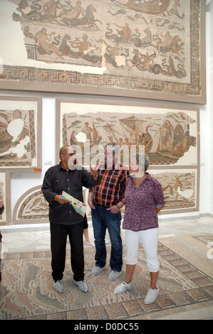 A guide talks to tourists at the Bardo Museum, Tunis, Tunisia. - Stock Photo