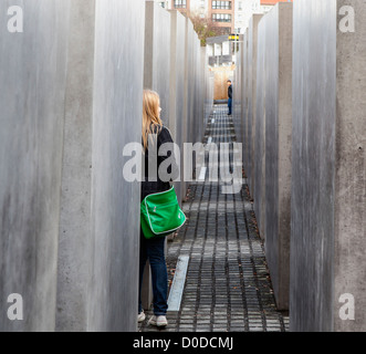 Two young people at the Holocaust Memorial in Berlin - Stock Photo