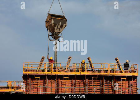 THE POURING OF A CONCRETE WALL ON A CONSTRUCTION SITE - Stock Photo