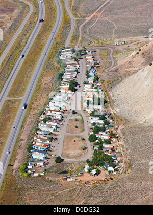 Aerial view of a mobile home or trailer park in Colorado's Rocky Mountains, adjacent to Interstate 70. - Stock Photo