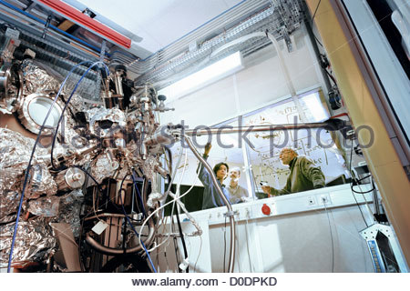 Scientists Scribble Formulas on the Window of a Beamline - Stock Photo