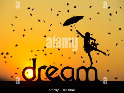 Silhouette girl with teddy bear and umbrella on DREAM word with falling stars at sunset. Childhood dreams concept. - Stock Photo