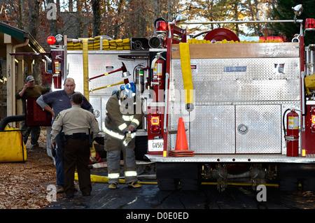 TIGER, GA, USA - NOV. 9: A group of firemen getting ready to fight a house fire. November 9, 2012, on Lake Burton. - Stock Photo