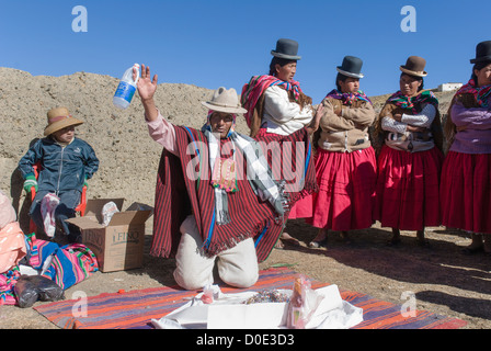Ceremony to the Pachamama in the  bolivian cordillera - Stock Photo