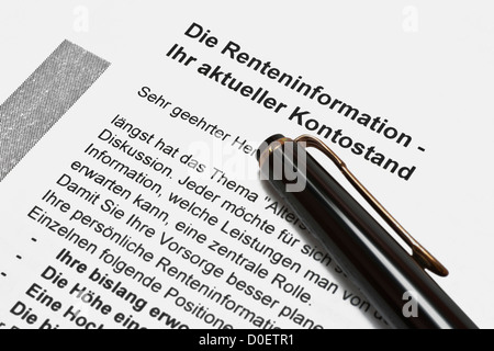 Detail photo of a letter with the annual pension information, German language, a pen lies alongside - Stock Photo