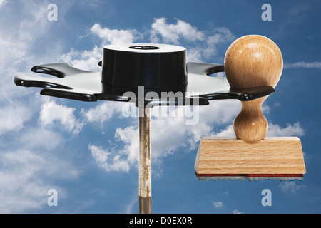 a stamp without inscription hangs in a stamp rack, background sky - Stock Photo