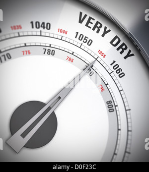 close up of a barometer with the pointer pointing on the word very dry, blur effect, red and gray colors - Stock Photo