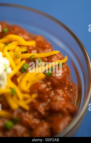 chili and cheese in a glass bowl - Stock Photo