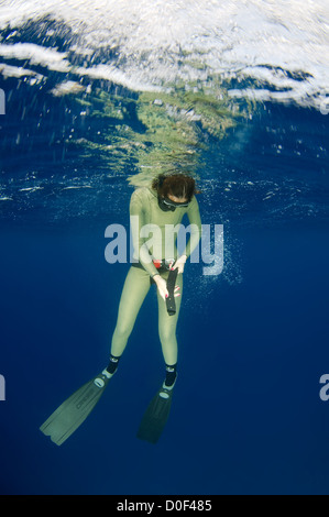 Female freediver  under water - Stock Photo