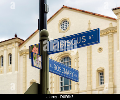Street sign at intersection of Rosemary Ave and Hibiscus St with Harriet Himmel Theater behind, West Palm Beach, - Stock Photo