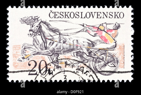 Postage stamp from Cechoslovakia depicting harness racing. - Stock Photo