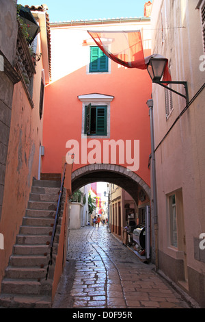 Old alley with archway  in Rab town, Island of Rab, Croatia - Stock Photo