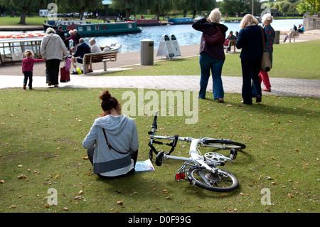 Cyclist sitting near to River Avon, Stratford-upon-Avon, UK - Stock Photo