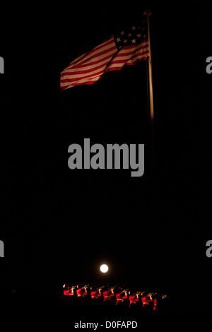 The moon shines bright as US Marine Drum & Bugle Corps buglers perform atop the ramparts during a Friday Evening - Stock Photo