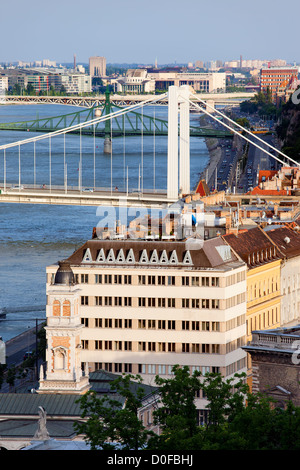 Scenic city of Budapest in Hungary with bridges over Danube river and tenement houses, view from above. - Stock Photo