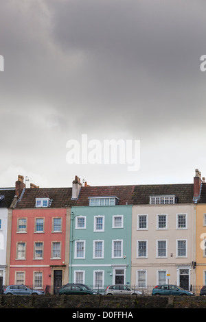 Pastel colour washed terrace overlooking the floating harbour in Bristol. - Stock Photo