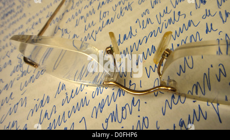 reading glasses on a piece of paper hand written, thinking, pause, break, reflection,meditating, presentation of - Stock Photo