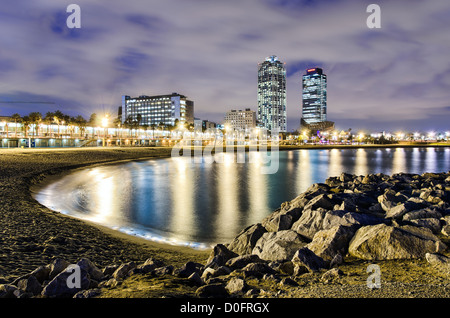 Coastline of Barcelona at night  with a view of hotel towers, Spain - Stock Photo