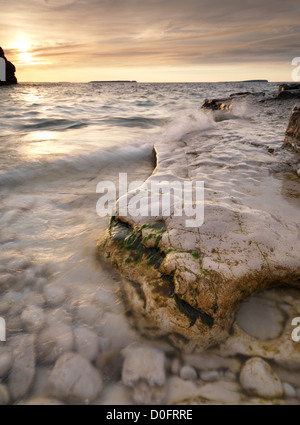 Gold sunset sky over rocky shore of Georgian Bay. Landscape nature scenery. Bruce Peninsula National Park, Ontario, - Stock Photo