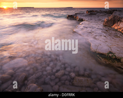 Georgian Bay, beautiful sunset nature scenery in golden colors. Bruce Peninsula National Park, Ontario, Canada. - Stock Photo