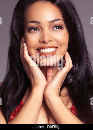 Beauty portrait of a happy smiling young black woman with long hair - Stock Photo