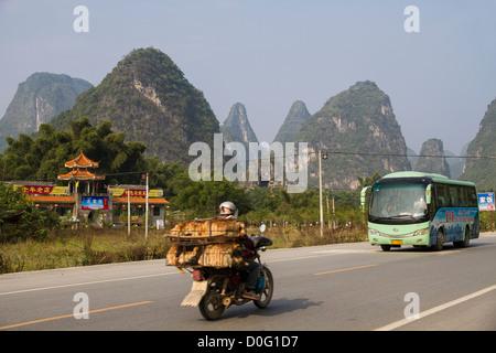 China Guangxi Yangshuo, road & Karst mountains - Stock Photo