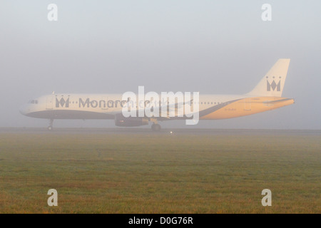 Monarch Airlines Airbus A321 taking off on a foggy morning - Stock Photo