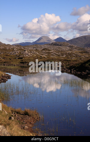 UK Scotland Western Isles Outer Hebrides Isle of Harris from a highland lochan and the Harris Mountains - Stock Photo