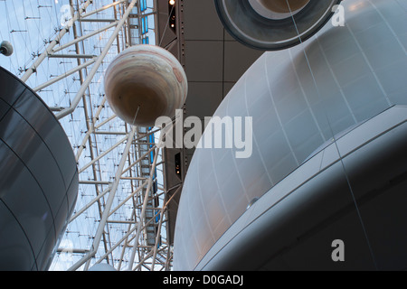 Planets circle the Hayden Planetarium Space Theater at the American Museum of Natural History in  New York City. - Stock Photo