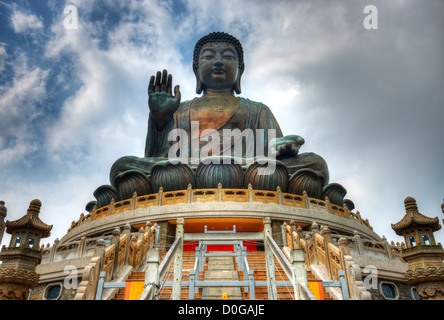 Tian Tan Buddha (Great Buddha) is a 34 meter Buddha statue located on Lantau Island in Hong Kong. - Stock Photo