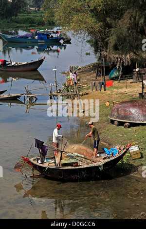 Coracle fishing boat on river, Hoi An, Vietnam - Stock Photo