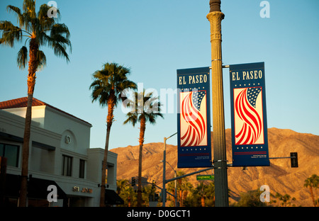 EL Paseo Drive in Palm Desert California with palm trees and mountain in background - Stock Photo