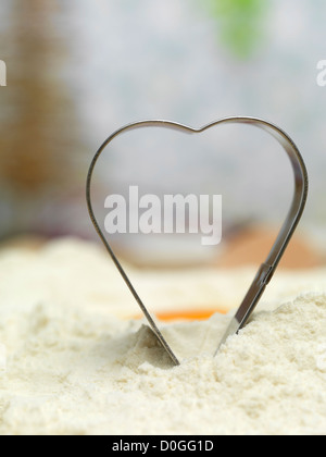 Metal gingerbread heart with holiday background - Stock Photo