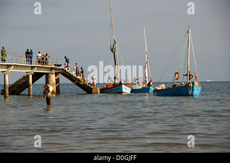Inhaca jetty is bustling with activity as local traders come to fetch their merchandise which has arrived from Maputo. - Stock Photo