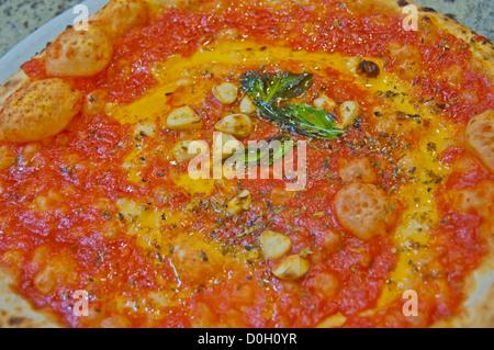 Pizza Marinara the pizza with tomato sauce garlic and basil in pizzeria along Spaccanapoli street Naples Italy - Stock Photo