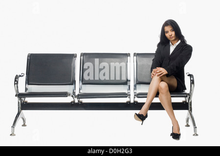 Businesswoman sitting on an armchair - Stock Photo