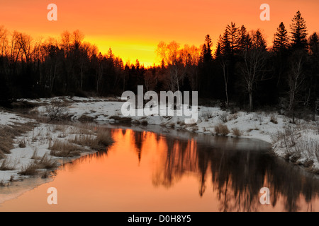 Junction Creek in early spring at sunrise, Greater Sudbury, Ontario, Canada - Stock Photo
